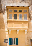 Balcony and window in Mdina. Traditional Maltese balcony and window in Mdina Royalty Free Stock Photos