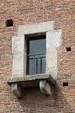 Balcony window of a medieval tower made of red bricks Royalty Free Stock Photo