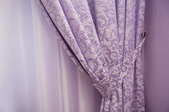 Balcony window with purple curtains Stock Photography