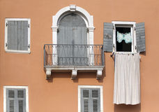 Balcony and windows on a pink house Stock Image