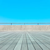 Balcony, Wood floor, concrete, blue sky Stock Photography