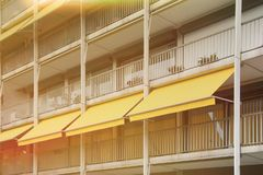 Balcony with yellow awning. royalty free stock images