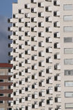 Balconys. Straight wall of high-rise building with hundreds of balconys seen from the sida Stock Photo