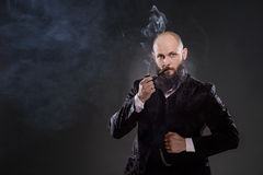Bald bearded man in a suit Stock Image