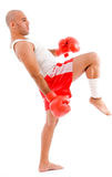 Bald boxer in kicking pose Stock Image