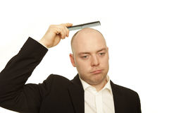 Bald business man with comb Royalty Free Stock Photography