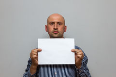 Bald business man is posing with blank copy space stock image