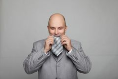 Bald businessman in a gray suit Royalty Free Stock Photography