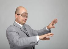 Bald businessman in a gray suit Royalty Free Stock Image