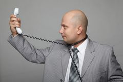 Bald businessman with the handset Stock Images