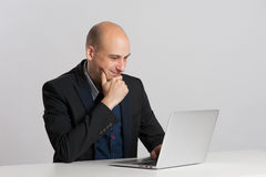 Bald businessman with laptop Royalty Free Stock Image
