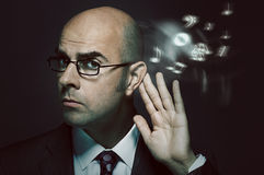 Bald businessman listening to music Stock Photo