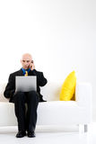 Bald Businessman Taking Call royalty free stock image