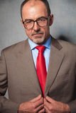 Bald businessman wearing glasses posing in studio background Royalty Free Stock Photography