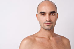 Bald Caucasian handsome man with topless shoulders. Portrait of a bald man.Man face close up Stock Images