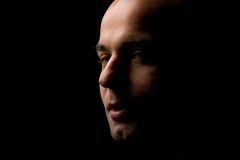 Bald in dark Stock Photography