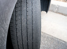 Bald front wheel tires on vehicle needing replacement Stock Photos