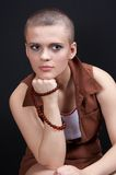 Bald girl 04. Bald girl with necklace in hand Royalty Free Stock Photo