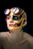 Bald girl with a art make up and steampunk glasses Stock Image