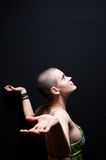 Bald girl looking up. Smiling Royalty Free Stock Photos