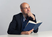 Bald guy reads a book Stock Photography