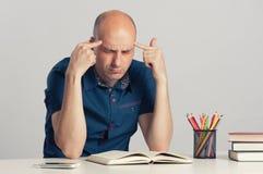 Bald guy serious thinking Stock Photos