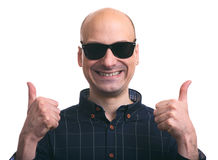Bald guy shows thumbs up. Isolated Royalty Free Stock Photos
