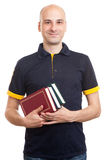 Bald handsome man with books Stock Images