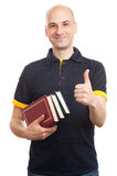 Bald handsome man with books Stock Photo