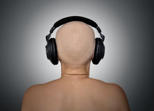 Bald head with headphones, rear view. Royalty Free Stock Images