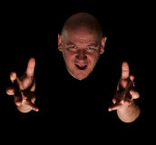 Bald headed man with arms outstretched stock image