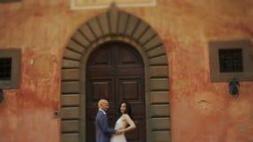 Bald-headed man hugs divine brunette tender stock footage
