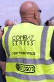 Bald headed man wearing high visibility jacket promoting 3-day t. Llandudno, Wales- May 18th  2014: Bald headed man wearing high visibility jacket promoting 3 Royalty Free Stock Photography