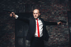 Free Bald Hired Killer In Red Tie Aims A Pistols Royalty Free Stock Photography - 90159877