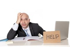 Bald latin business man over worked holding a help sign Stock Image