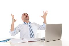 Bald latin businessman screaming at his latop Stock Photos