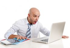 Bald latin businessman screaming at his latop Stock Image