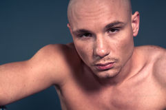 Bald man. Studio portrait of shirtless muscled bald man Stock Photo