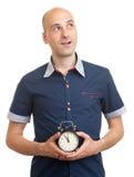 Bald man with an alarm clock Stock Photo
