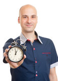 Bald man with an alarm clock Royalty Free Stock Photography