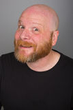 Bald Man with a beard. A bald man with a red beard and a happy expression Royalty Free Stock Photo
