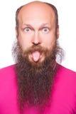 Bald man with big eyes and tongue. Royalty Free Stock Photography