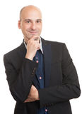 Bald man in black suit thinking Royalty Free Stock Photos