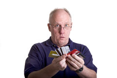Bald Man in Blue Shirt Showing Credit Cards Royalty Free Stock Images