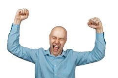 Bald man rejoices in victory. Bald man in blue shirt on a white background rejoices in victory Stock Images