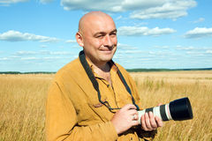 Bald man with camera Stock Image