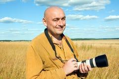 Bald man with camera Stock Image