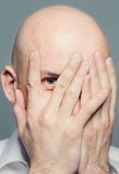 Bald man with closed face Stock Image