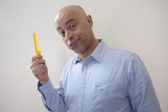 Bald man with comb. Concept Royalty Free Stock Images