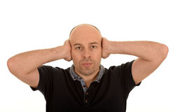 Bald man covering ears Royalty Free Stock Photo